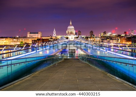 Millennium Bridge leads to Saint Paul's Cathedral in central London at night.