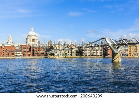 Millennium Bridge, River Thames and St Paul's Cathedral on the backgrounds in the evening. London, Great Britain.