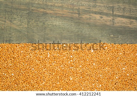 Millet cereal grains wooden background