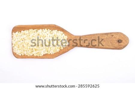 Millet flakes on shovel - stock photo