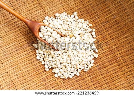 Millet (grain) in the basket. - stock photo