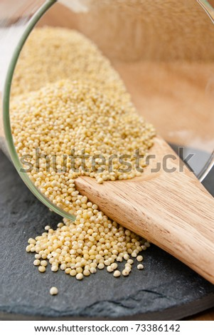 Millet in a glass on a workplate.