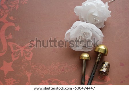 Millinery hat making tools silk flowers stock photo 630494447 millinery and hat making tools silk flowers and thimble mightylinksfo