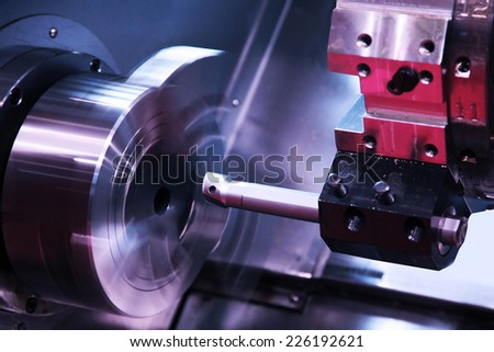 milling detail on metal cutting machine tool at factory  - stock photo