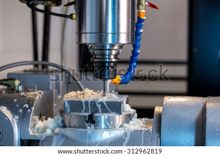 Milling machine. Close-up of grease on cutter - stock photo