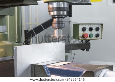 Milling machine face on top stainless steel on bench vise - stock photo