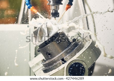 Milling metalworking process. Industrial CNC metal machining by vertical mill - stock photo