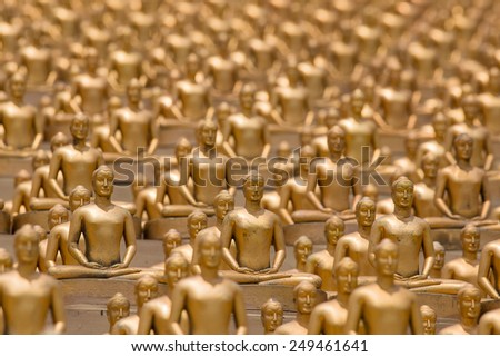 Million golden Buddha figurine in Wat Phra Dhammakaya. Buddhist temple in Bangkok, Thailand - stock photo