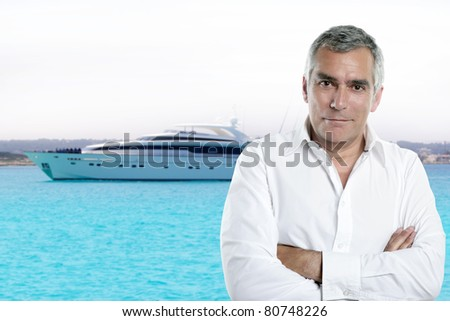 millionaire senior posing in front a luxury yacht during summer vacation [Photo Illustration] - stock photo