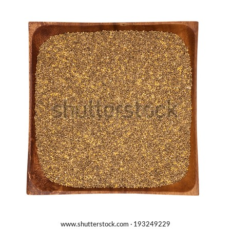 Milllet in a wooden bowl on white background