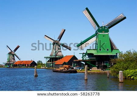 Mills in Holland, traditional and direct landmark of the country - stock photo