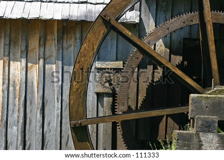 Millwheel and gears - stock photo