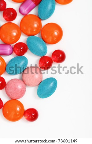 Milticolor pills and capsules on white background - stock photo