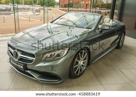 MILTON KEYNES, ENGLAND - JULY 26, 2016. Mercedes Benz 2016 E Class Coupe model at Mercedes-Benz head office office - stock photo