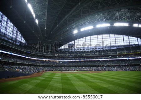 MILWAUKEE - APRIL 24: Brewers prepare to battle the Chicago Cubs under a closed dome at Miller Park on April 24, 2010 in Milwaukee, Wisconsin. The park opened in 2001 at a cost of $400 million. - stock photo