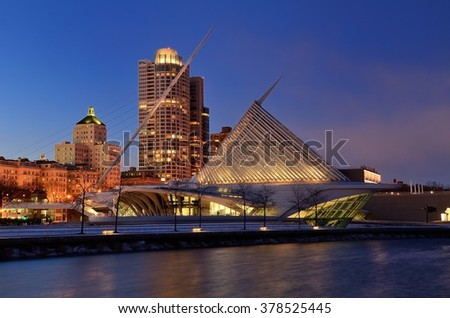 MILWAUKEE, WI - FEBRUARY 12 2016: Milwaukee Art Museum and Downtown Skyline at Dusk - stock photo