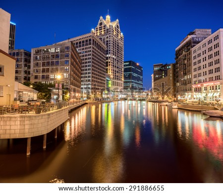 Milwaukee WI - 6 June 2015: Downtown Milwaukee on the river walk at night. - stock photo