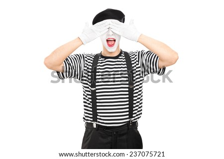 Mime artist covering his eyes isolated on white background - stock photo