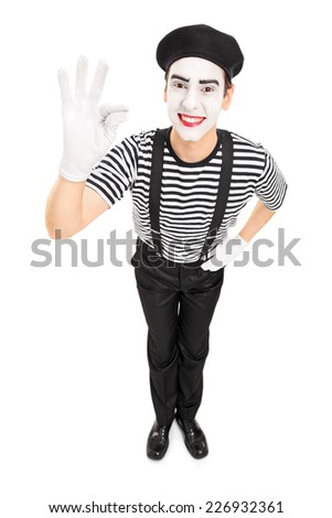 Mime artist gesturing with his hand isolated on white background - stock photo