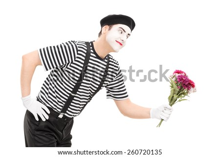 Mime artist giving flowers to someone isolated on white background - stock photo