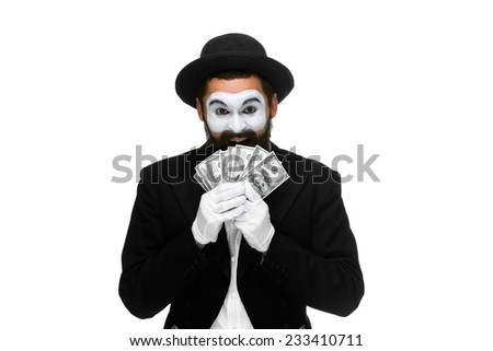 mime as a businessman holding dollar bills  isolated on a white background. concept of money luck - stock photo