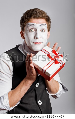 Mime holding one box of present - stock photo
