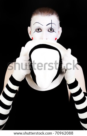 mime holding white hat - stock photo