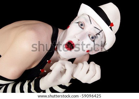 mime in striped gloves and white hat isolated on black background closeup