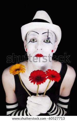 mime in white hat with bouquet of red gerberas - stock photo