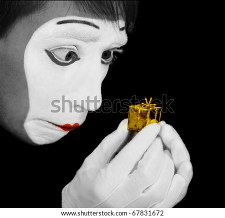Mime is upset of too little gift - stock photo