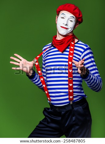 mime playing fool pulls  harness - stock photo