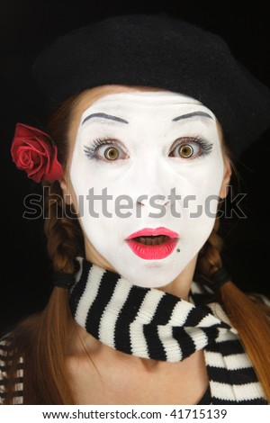 Mime portrait with surprised face expression isolated over black background - stock photo