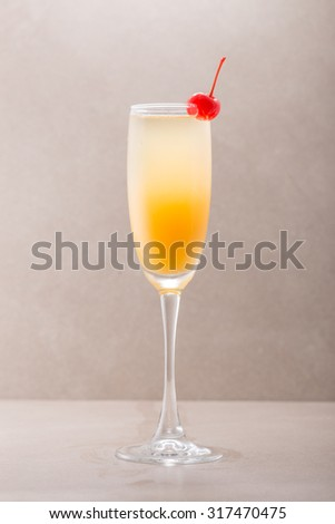 Mimosa cocktail isolated on grey background - stock photo