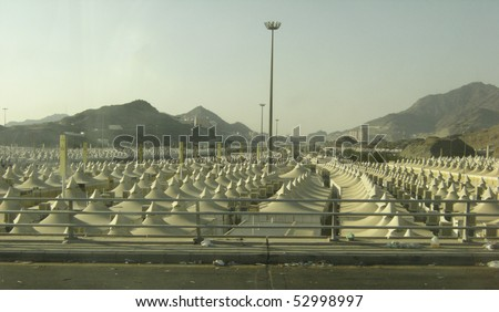 MINA - DEC 22 : Rows of pilgrims tents on Dec 22, 2007 in Mina, Saudi Arabia. These tents made of fire-proof materials house millions of pilgrims for three to five days during hajj period - stock photo