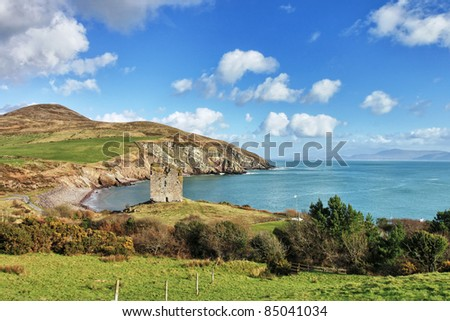 Minard Castle on a hill with cliffs in background, Co Kerry in Ireland. - stock photo