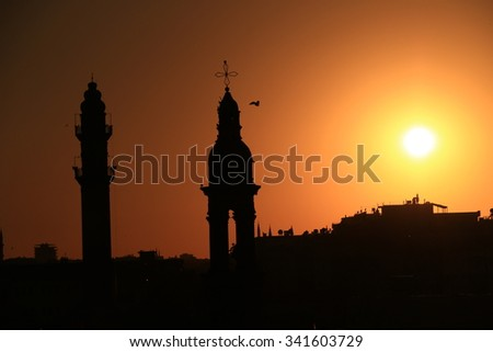 minaret and bell tower silhouette