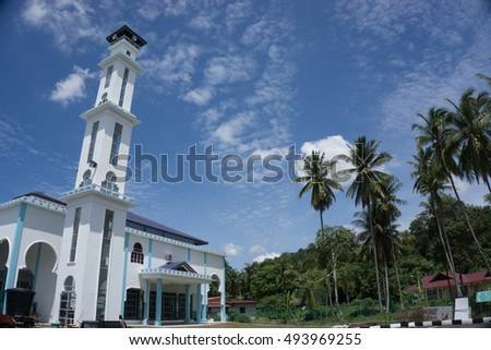 Minaret of mosque against the blue sky