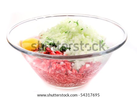 mince meat and chicken egg in bowl - stock photo