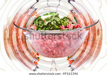 mince meet inside transparent bowl over white - stock photo