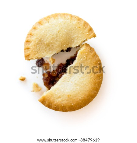 Mince Pie broken in half showing mince, isolated on white background with shadow
