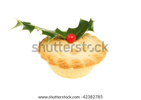 Mince pie decorated with a holly sprig - stock photo