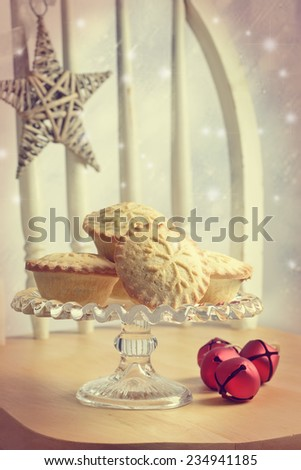 Mince pies on glass cake stand  - stock photo