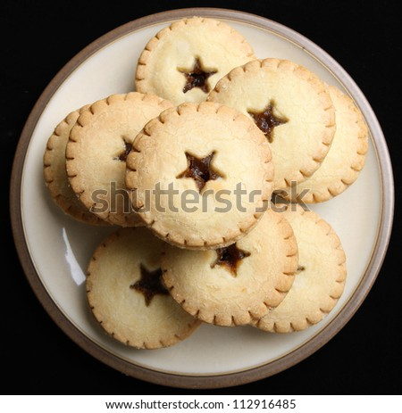 Mince pies stacked on a plate - stock photo