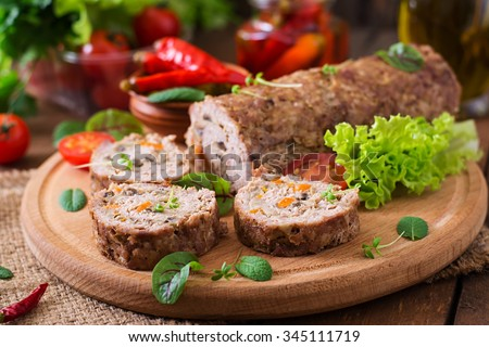 Minced meat loaf roll with mushrooms and carrots - stock photo