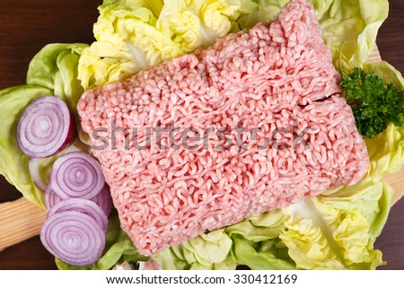 Minced meat on the wooden cutting board - stock photo