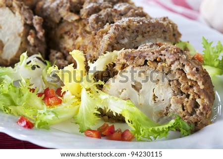 Minced meat roll stuffed with cauliflower. - stock photo