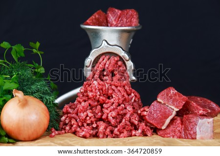 Mincer with fresh minced meat. - stock photo