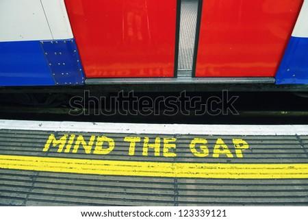 Mind the gap, warning in the London underground - UK - stock photo