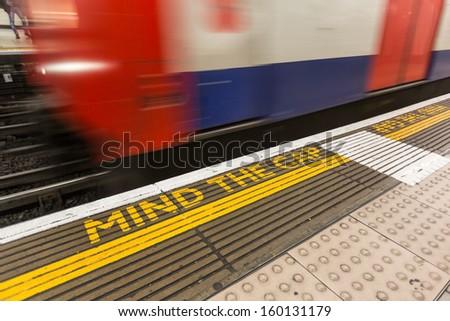 Mind the Gap Writing into London Underground - stock photo