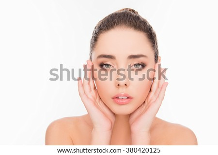 Minded sensitive girl touching her face, close up photo - stock photo